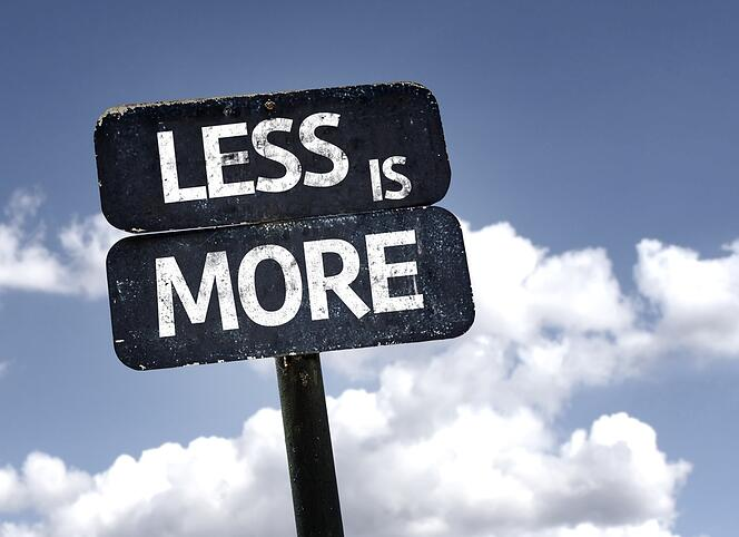 Less is More sign with clouds and sky background.jpeg